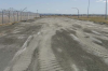 Site 32, Photo #4  Backfill gravel area, April 2008. (Navy contractor TetraTech, ECI photo)